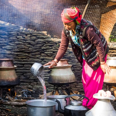 Boiling water to make wine from millet
